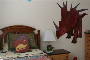 Dinosaur on little boy's wall