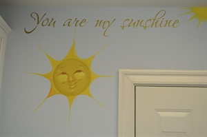 detail of You Are My Sunshine mural in a laundry room